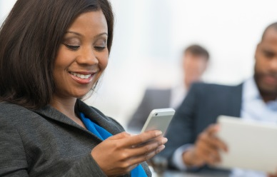 young professional nigerian lady using phone
